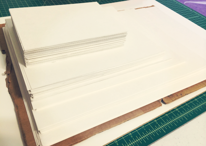 What I spent yesterday doing - cutting all of the the cardstock backings for packaging my prints.